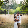 bride-and-groom-hugging-at-the-wedding-in-nature-Z2AVSJ4